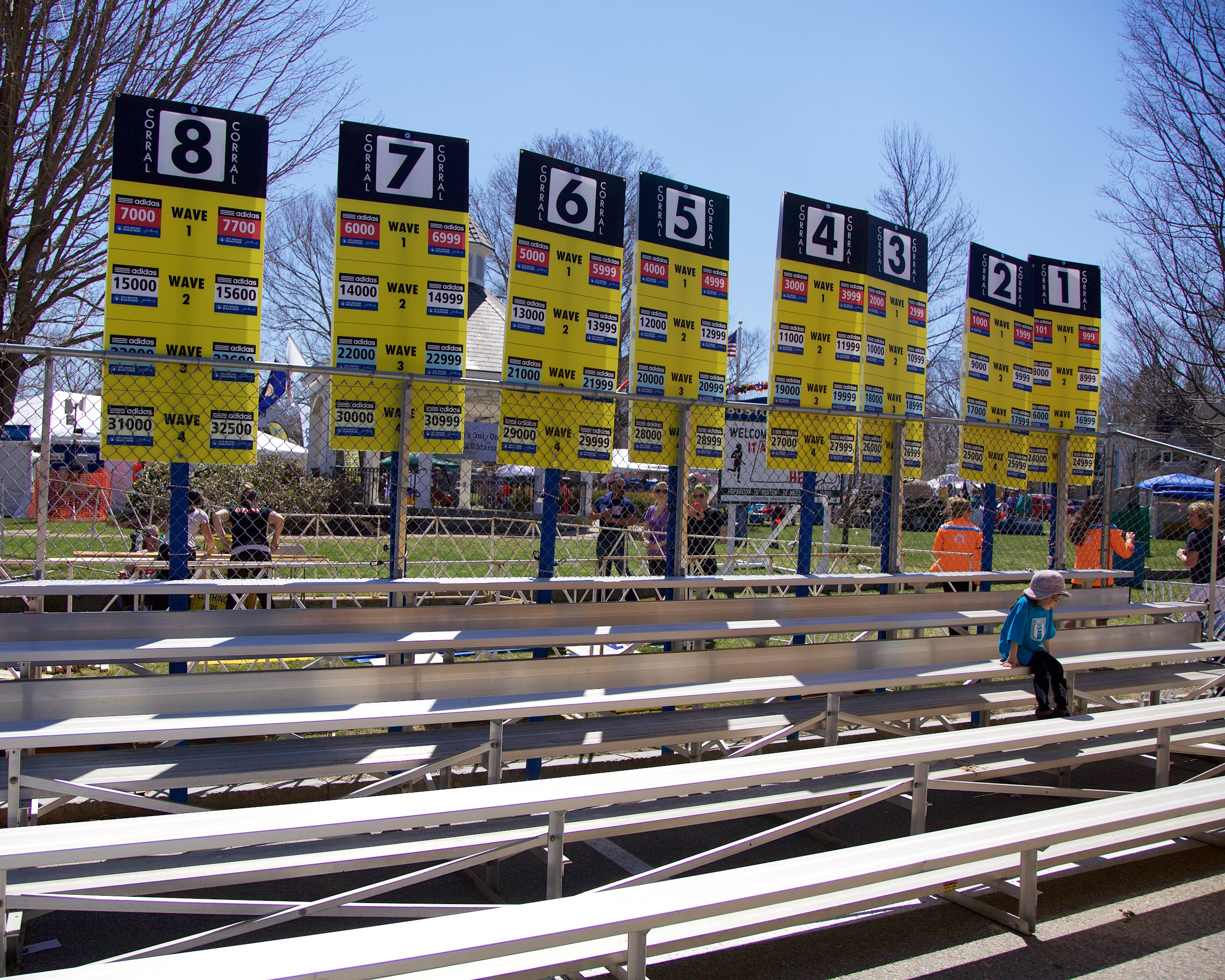 Officials prep the corrals for Monday's race.
