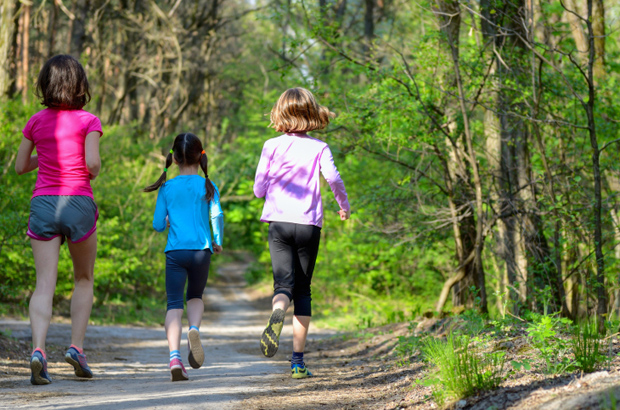 Family sport, active mother and kids jogging, running in forest